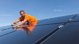 Solar Installer checking on Panels