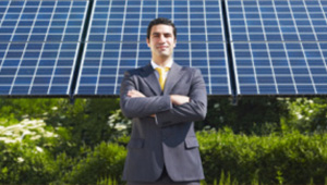 Solar Representative in front of solar panels