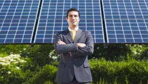 Solar Representative in front of solar panels